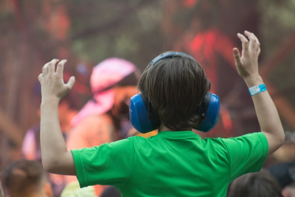 A child watching live music at a festival.