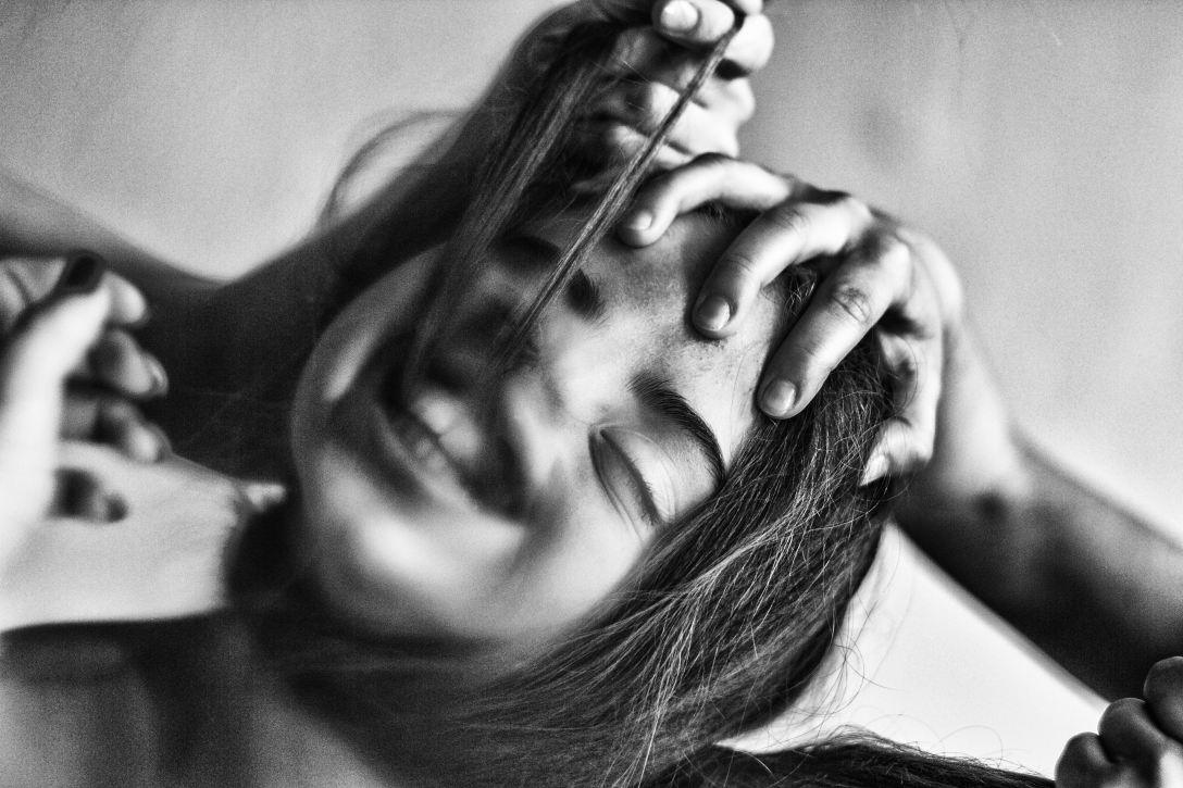 black and white photo of girl laughing